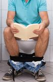 Close-up of a man in toilet Stock Photography