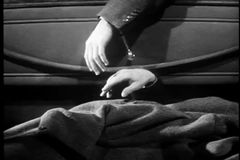 Close-up of man touching dead body's hand in car trunk stock video footage