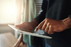 Close-up of a man touching on digital tablet stock photography