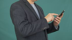 Close up man touching smartphone screen for searching information in internet stock video footage
