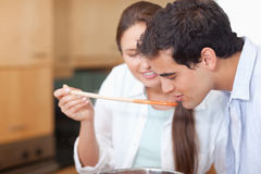 Close up of a man trying his wife's sauce Stock Photo