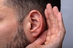 Close-up Of A Man Trying To Hear stock photos