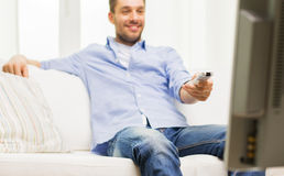 Close up of man with tv remote control at home Stock Photo