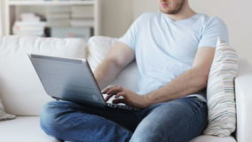 Close up of man typing on laptop at home stock video footage