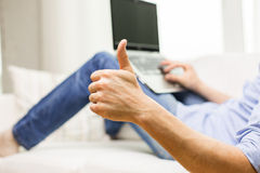 Close up of man typing on laptop at home Royalty Free Stock Photo