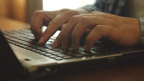 Close up of man is typing on a notebook stock video
