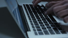 Close up man typing text on laptop keyboard. Businessman checking stock market at his laptop computer stock video footage