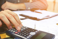 Close up man using calculator in home office. Close up man using calculator in home office stock photography
