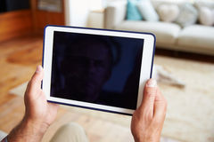 Close Up Of Man Using Digital Tablet At Home Stock Image