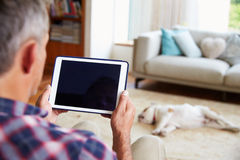 Close Up Of Man Using Digital Tablet At Home Royalty Free Stock Image