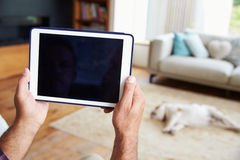 Close Up Of Man Using Digital Tablet At Home Royalty Free Stock Photography