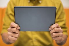 Close-up of a man using a digital tablet Royalty Free Stock Image