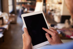 Close Up Of Man Using Digital Tablet In Shop Royalty Free Stock Image