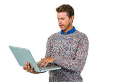 Close-up of man using laptop Stock Photography