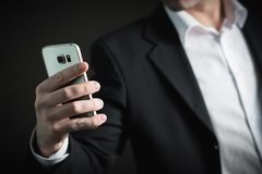 Close-up of Man Using Mobile Phone Stock Photos