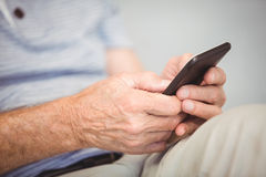 Close-up of man using mobile phone Stock Image