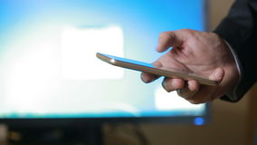 Close up of a man using mobile smart phone. the background monitor. Close up of a man using mobile smart phone stock video footage
