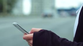 Close up of man using mobile smart phone. Close up of man hands using mobile smart phone. Being outdoors stock video footage