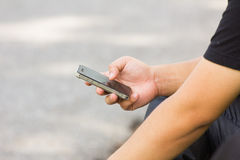 Close up of a man using mobile smart phone Royalty Free Stock Image