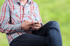 Close up of a man using mobile smart phone Stock Photos