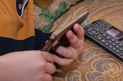 Close up of a man using mobile smart phone. A mobile phone in the hands. Playing on the phone Royalty Free Stock Photos