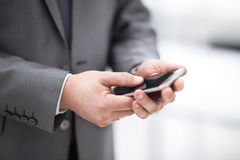 Close up of a man using mobile smart phone. In office Stock Image