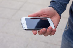 Close up of a man using mobile smart phone outdoor. Stock Image