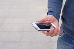 Close up of a man using mobile smart phone outdoor. Stock Photo