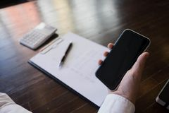 Close up of a man using mobile smart phone on the table stock images