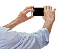 Hands with mobile camera phone Royalty Free Stock Images