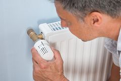 Close-up of a man using radiator Stock Photography