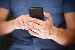 Close up of a man using smart phone Stock Images