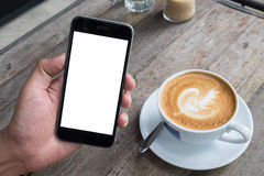 Close up of a man using smart phone with blank mobile and cup of. Coffee .Smart phone with blank screen and can be add your texts or others on smart phone Royalty Free Stock Images