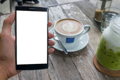 Close up of a man using smart phone with blank mobile and cup of. Coffee .Smart phone with blank screen and can be add your texts or others on smart phone Royalty Free Stock Image