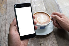 Close up of a man using smart phone with blank mobile and cup of. Coffee .Smart phone with blank screen and can be add your texts or others on smart phone Stock Images