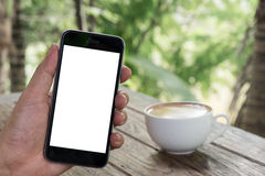 Close up of a man using smart phone with blank mobile and cup of. Coffee .Smart phone with blank screen and can be add your texts or others on smart phone Stock Photography
