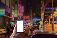 Close up of a man using smart phone with blank mobile and night. Street blur background .Smart phone with blank screen and can be add your texts or others on Royalty Free Stock Photos