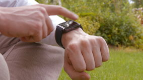 Close up of man using a smart watch stock footage
