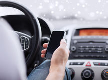Close up of man using smartphone while driving car Stock Photos
