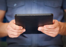 Close up of a man using tablet pc Royalty Free Stock Photos