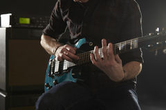 Close Up Of Man Using Tapping Technique On Electric Guitar Stock Image