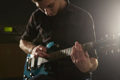 Close Up Of Man Using Tapping Technique On Electric Guitar Royalty Free Stock Photos