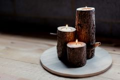 Woodwork project making three rustic wooden tea light candle holders royalty free stock photos