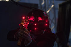 Close-up of man using vr glasses and weapon gun. Los Angeles, USA - April 15, 2017: Close-up of man using vr glasses and weapon gun during the VRLA Expo royalty free stock photography