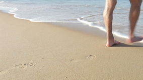 Close Up Of Man Walking Along Beach And Into Sea Stock Photography