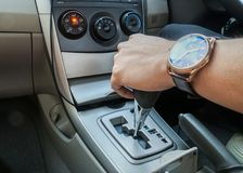 Close up man with watch hold the car gear while driving the car Royalty Free Stock Images