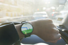Close up of man watching  smartwatch and using application Google Maps Stock Photography