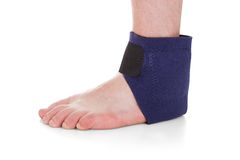 Close-up Of Man Wearing Brace On Foot Royalty Free Stock Photography