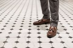 Close-up a man wearing brown leather shoes, classic style. S Stock Photo