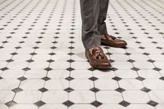 Close-up a man wearing brown leather shoes, classic style. S Stock Photography